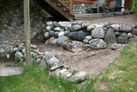 Landscaping job rock wall - Cutting Edge Caretaking